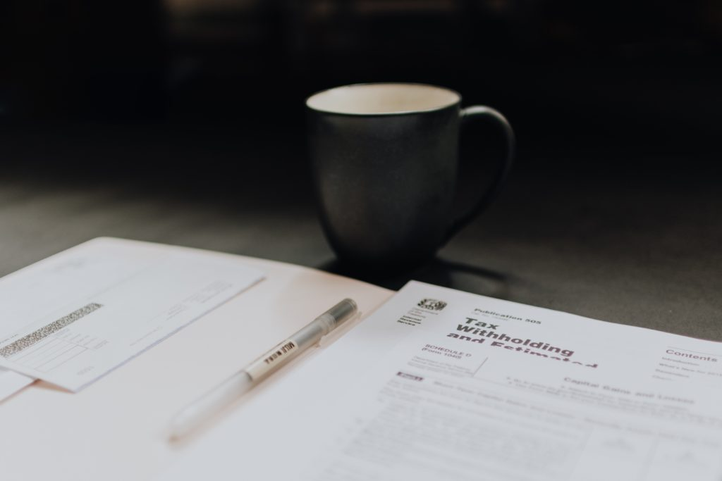 Paperwork with coffee cup