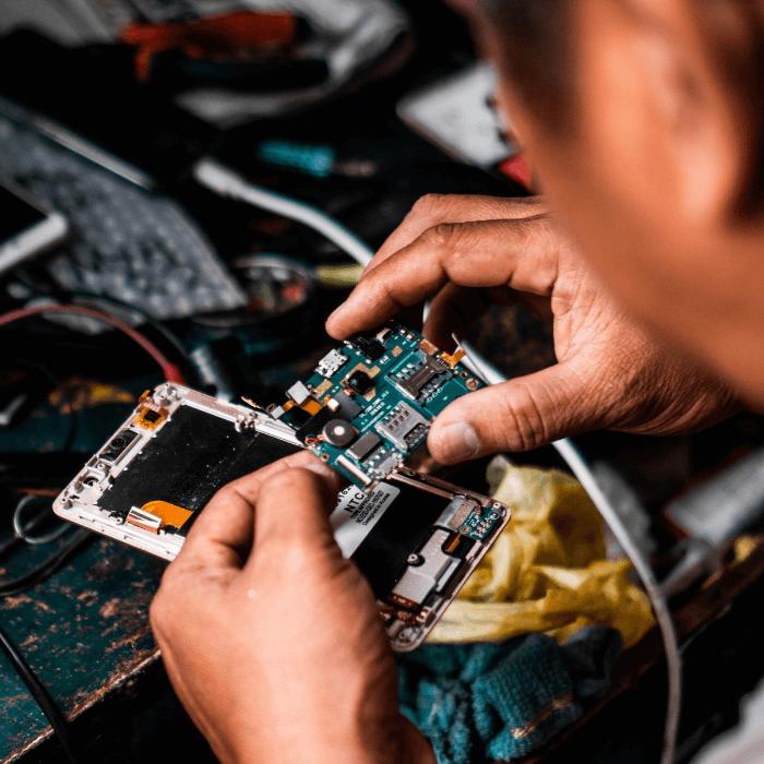 engineer repairing printer